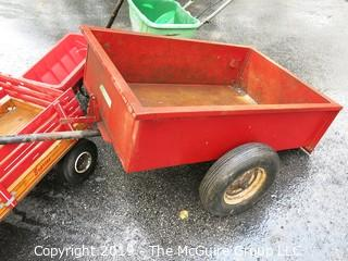 Collection including wooden red Wagon, tractor pulled metal dump wagon and (2) fertilizer spreaders