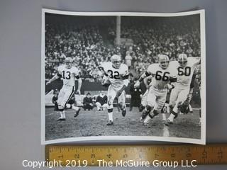 "8 x 10"" B&W photo of #32 Jim Brown, running back for the Cleveland Browns, in game action; taken by Robert J. Quinlan (#13 is Frank Ryan)"