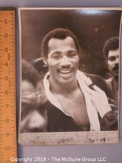 Collection of large format B&W boxing photos including Ken Norton