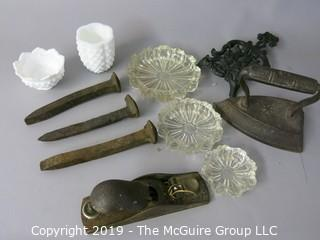Collection including flat iron, trivet, block plane, ashtrays, milk glass and hand forged railroad spikes