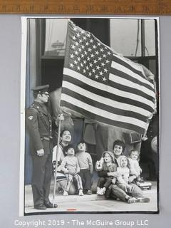 Photo: credited: Historical; Americana: Art: patriotic families during Flag Day 1977