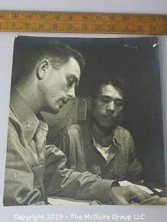 Photo: unaccredited: Historical; Americana:post-WWII US Lt talking to Asian soldier