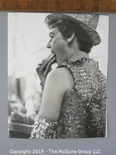 Photo: uncredited: Historical; Americana: Parade girl eating a hot dog