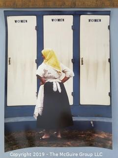 Photo: uncredited: Historical; Americana: woman waiting to use restrooms