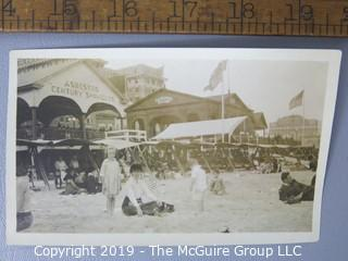 Photo: uncredited: Historical; Americana: turn of century beach scene by city ADVERTISING