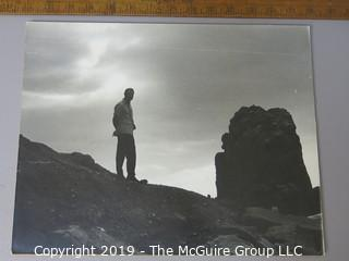 Photo: unaccredited: man in silhouette by rocks on board