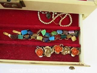 "Jewelry: ""The Rest"" jewelry box includes all the things that did not get put into other lots. Look at all the photos carefully, there could be a gem we missed. Mgt."