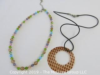 Jewelry: 2 necklaces - shell and plastic crystal beads