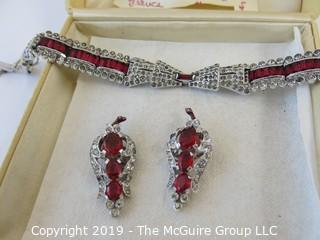 Jewelry: Quality faux ruby and rhinestone bracelet and earring set with necklace. Similar to the HEART brooch. Could not find any markings.